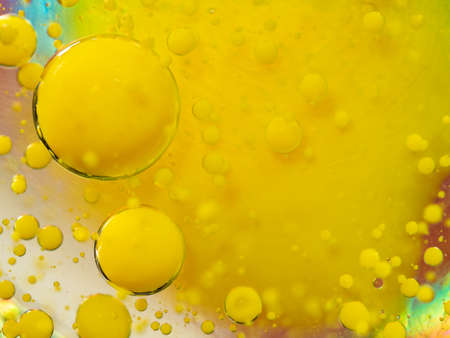 Scores of yellow paint bubbles, abstract background. Close up macro shot. Blurred background. Selective soft focus. Glittering spheres on yellow spot. Pattern of yellow bubbles, an abstract universe Standard-Bild - 120476448