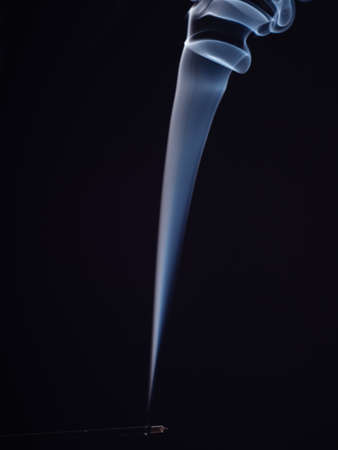Abstract smoke steam from burning incense, isolated on black background, close up view. Structure of white smoke, brush effect. Abstract background. Fragrance for relaxation and meditation