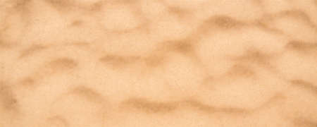 Sand on the beach, top view. Long blurred background with sand on tropical beach. Defocused vector background, EPS10.