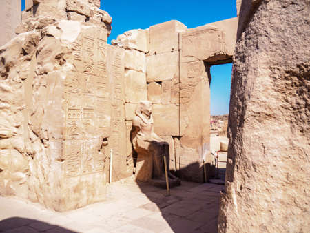Ancient ruins in Karnak temple, medium view. Architectural complex in Luxor, Egypt. Selective soft focus. Blurred background