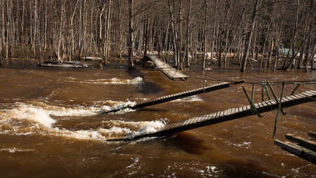 flooded river with broken bridge photo