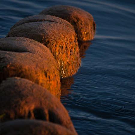 breakwater posts in sunset photo