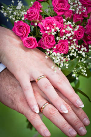 bridal bouquet: wedding rings with bridal bouquet Stock Photo