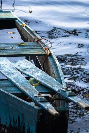 sunken boat: The sunken wooden boat