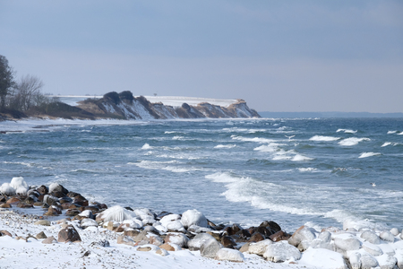 Winter coast with storm
