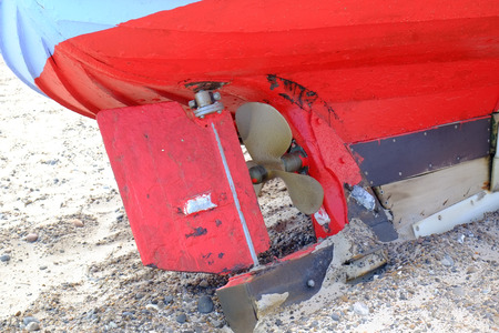 Boat hull lies diagonally on the beach