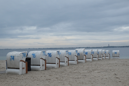 Beach chairs are cleaned up on the beach Redakční