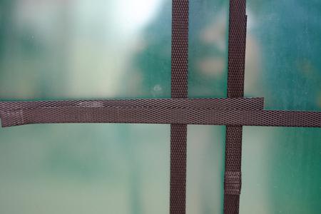 Lashing straps hold glass panes Stock Photo