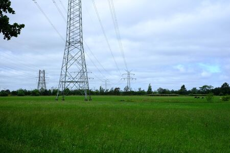 Power lines with lattice mast 免版税图像