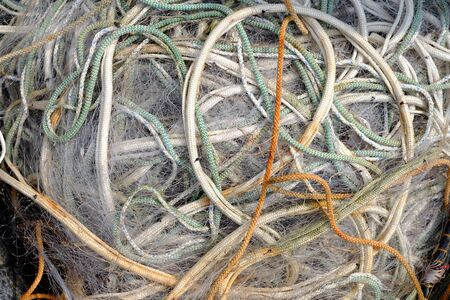 Unsorted ropes at a fishing port Stock Photo - 129325629