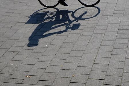 Silhouette of a cyclist on the walkway Stok Fotoğraf