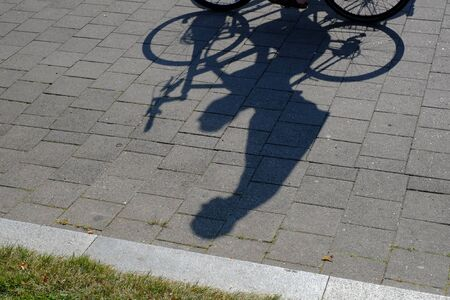 Shadow of a cyclist - drives freehand