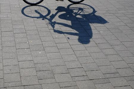 Outlines of a cyclist on the sidewalk Stok Fotoğraf
