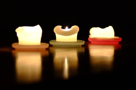 Three candles brighten the environment