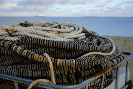 Ropes on the harbor overlooking the sea