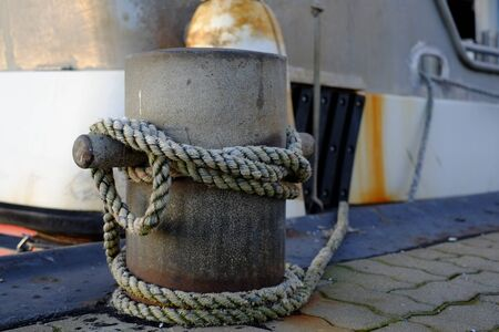 Big bollard with ropes at the harbor Stok Fotoğraf
