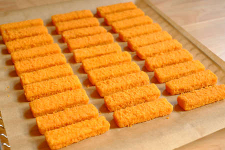 Fish fingers on a baking sheet