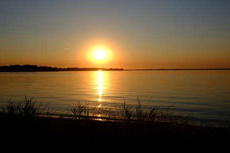 Sunset on an inland body of water Standard-Bild