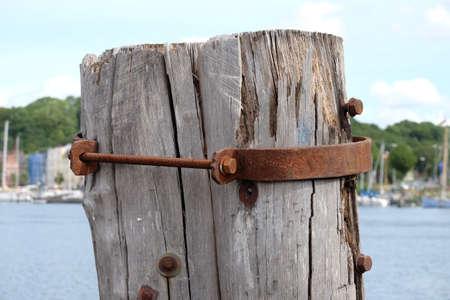 Wooden bollard with steel collar Standard-Bild