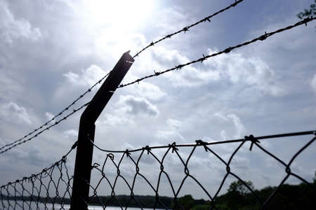 Dangerous barbed wire with chicken wire