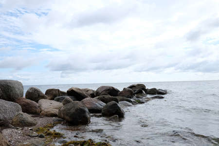 Rocks protrude into the Baltic Sea as breakwater