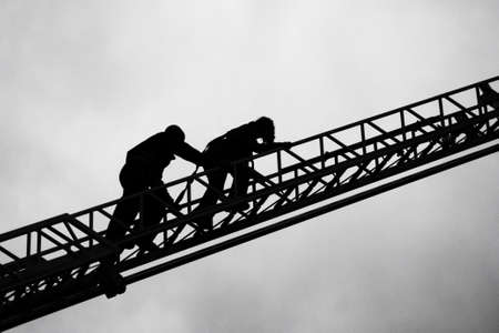 Firefighter and child on ladder