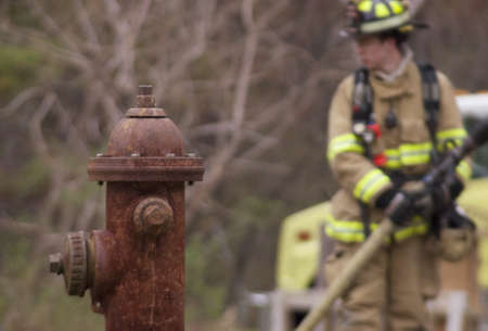 fire hydrant: Fire Hydrant with Firefighter
