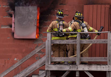 Firefighters Waiting to go in Burn House for Training Editorial