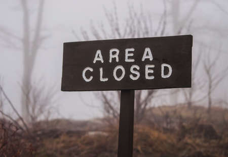 Outdoor Wooden Sign that says Area Closed Stock Photo