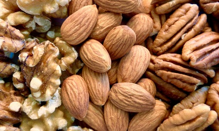 pecans: Almonds, pecans, and walnuts arranged in stripes