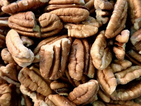 pecans: Pile of pecans close up Stock Photo