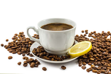 Cup of coffee with lemon and grains isolated on white