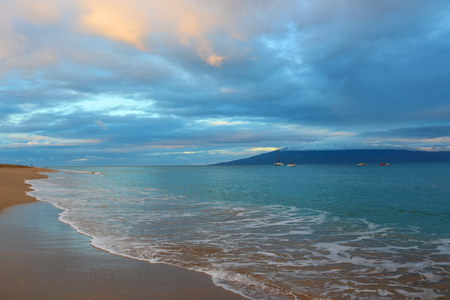 Empty Beach at Sunrise with Blue Turquoise Water and Silver Sky