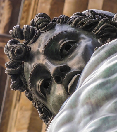 Bronze Antique Statue of Perseus in Florence Italy Piazza Stares Down at Camera 写真素材