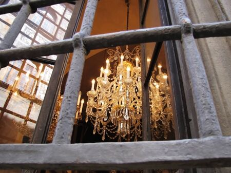 Elegant Chandelier Behind Iron Bars in Italy