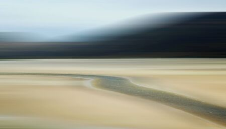 Abstract Motion Blur of Sandy Tidal Plain and River of Water 免版税图像