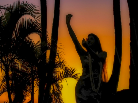 Hula Dancer with Graceful Hands in Silhouette Against Sunset