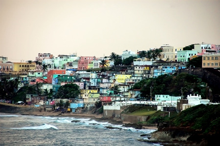 Crowded Homes on Coastline of Puerto Rico in Bright Colors Stock Photo