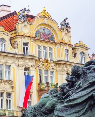 Statue Building and Flag Layers of History in Town Square Prague