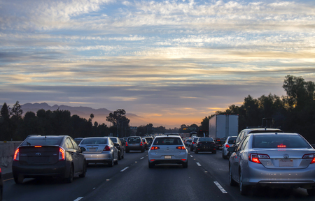 Crowded Freeway as Sun Rises in Distance
