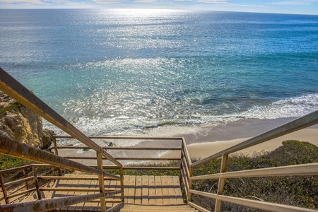 Staircase Descends Onto Beach with Vast Ocean at Malibu