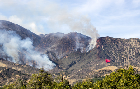 Two Types of Air Attack over Thomas Fire in Fillmore California Stock Photo