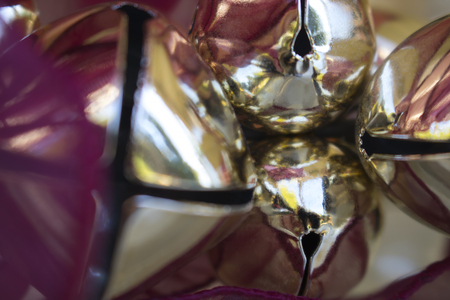 Close Up Gold and Burgundy Colored Bells Stock Photo
