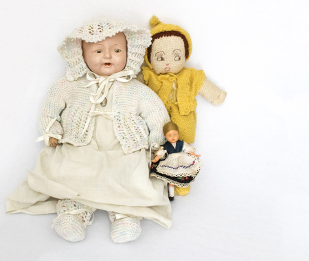 Three Antique and Vintage Dolls Grouped on White Background