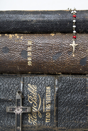 Close Up Worn Leather Antique Bibles with Cross and Rosary
