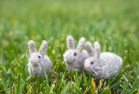 Three Tiny Wool Felted Bunny Rabbits on Green Grass