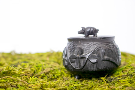 Close Up Small Hand Carved Antique Black Bog Oak Irish Pot with Pig Lid on Moss