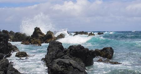 Turquoise Ocean Coastline with Waves Breaking on Lava Rocks