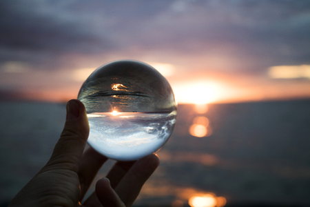 Ocean Sunset with Sun on Horizon Taken Through Crystal Ball