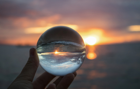 Sunset Seascape Captured in Clear Glass Globe